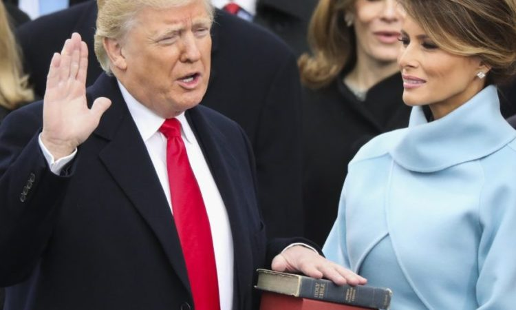 Donald Trump is sworn in as the 45th president as Melania Trump holds a bible Trump's mother gave him when he was a boy atop the bible used by President Lincoln at his first inauguration. (© AP Images)
